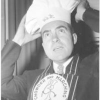 Richard Nixon adjusts his chef's hat during a birthday party given to him by fellow members of the Chowder and Marching Club of Washington. Nixon played piano to accompany a quarter of members during the party