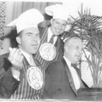 Richard Nixon sings during a birthday party given to him by fellow members of the Chowder and Marching Club of Washington. L-R: Band leader Benney Thompson, Ohio Representative William Hanes Ayres, and Nixon