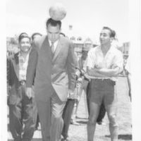 Vice President Richard Nixon heads a soccer ball during preliminary soccer game ceremonies at Quito's stadium in Ecuador