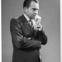 Richard Nixon attends a press reception during his trip to London