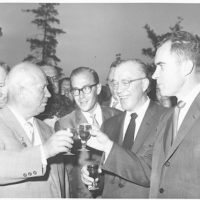 Soviet Premier Nikita Khrushchev toasts a glass of American wine with Richard Nixon at the American Exhibition in Sokolniki Park, Moscow