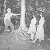 """Photograph of Ranger Tony Quinkert Explaining the Place and Importance of Valuable Hardwoods on the Demonstration Trail During a """"Trees for Tomorrow"""" Conservation Workshop at Eagle River, Wisconsin"""