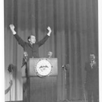 Richard Nixon gives his last speech as Vice President at the Ford Auditorium in Detroit, Michigan. Nixon raises both arms in the air