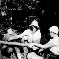 Photograph of Girl Scouts Lashing Poles Together at Camp Tocanja