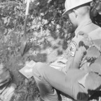 Photograph of Soil Scientist Arnold Armstrong Testing Soil