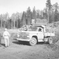 Photograph of Corpsmen Loading Gravel on a Dump Truck