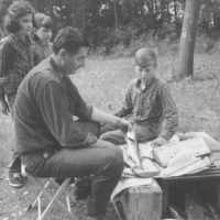 Photograph of Camper Cleaning Walleye Pike