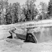Photograph of Corpsmen from Lydick Lake Civilian Conservation Center (CCC) Installing Boat Landing Mats