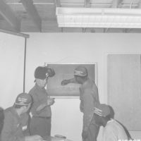 Photograph of Corpsmen from Lydick Lake Civilian Conservation Center (CCC) Receiving Instructions in Vocational Training Welding Course