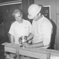 Photograph of Corpsmen Routing Signs in Sign Shop at Lydick Lake Civilian Conservation Center (CCC)