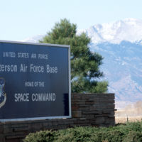 A Sign At The Entrance To Peterson Air Force Base Home Of The Us Air