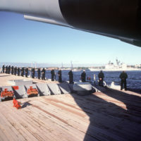 Residents of Kiel watch the arrival of the battleship USS