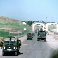 US Army personnel fill a M50A3 2 1/2 ton water tanker truck from a