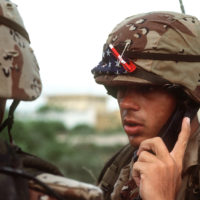 A marine radio operator listens to a mesage during the