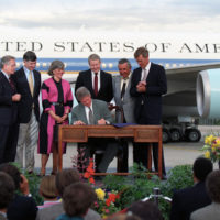 Photograph of President William J. Clinton Signing a Wilderness Act on the Tarmac of the Stapleton International Airport in Denver, Colorado