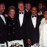 Photograph of President William J. Clinton Posing with Members of His Administration at the Congressional Black Caucus Dinner