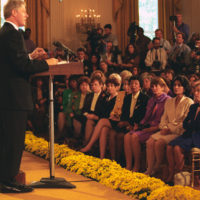 Photograph of President William J. Clinton Addressing a National Breast Cancer Coalition Event
