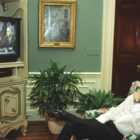 Photograph of President William J. Clinton Watching Vice President Albert Gore and Ross Perot Debate the North American Free Trade Agreement (NAFTA) on Television at the White House