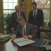 Photograph of President William Jefferson Clinton Signing an Executive Order for the Establishment of the National Science and Technology Council in the Oval Office of the White House in Washington, D.C.