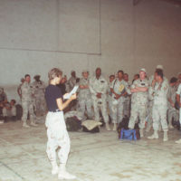 MSGT Diane Ensor from PERSCO briefs personnel waiting to depart for their home stations. (Screen resolution only)