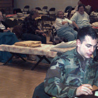 SGT. John Ott, C Company, 10th Forward Support Battalion, coordinates medical support for victims of an ice storm which left thousands of North Country people without light or heat. This shelter, located in Potsdam, NY, is housing more than 1,200 people in the aftermath of the storm. SGT. Ott is a combat medic with Fort Drum's 10th Mountain Division. Fort Drum personnel are working around the clock in support of communities crippled by the recent ice storm. Soldiers are augmenting community clean-up efforts and providing trucks, electrical power, mobile kitchens, heaters, and more than 60,000 sand bags