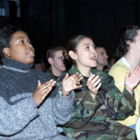 "From left to right, AIRMAN First Class Toni D. Topps, 86th Supply Squadron, A1C Maria Chavez, 86th Mission Support Squadron, and AIRMAN Amanda Bashore, 786th Communications Squadron enjoy the festivities of the Secretary of Defense Holiday Show 2000, ""A tribute to the Air Force."" The event took place at Ramstein Air Base, Germany, on December 17th, 2000"