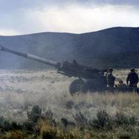 Silhouetted against the sky, Sergeant Mario Mezias, USMC, a