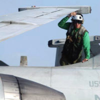 A US Navy (USN) aviation electronics technician 3rd class (AT3) performs a post flight check (Dailies) on an S-3B Viking from Sea Strike Squadron Twenty-One (VS-21), of Carrier Air Wing (CVW-5). Dailies are conducted on an aircraft after every flight to ensure no in-flight damage occurred. On board the aircraft carrier USS KITTY HAWK (CV 63), during Operation ENDURING FREEDOM