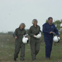 National Park Service Director Fran Mainella, Secretary Gale Norton, and Florida Congressman E. Clay Shaw, Jr., left to right, walking after aircraft arrival for Everglades tour. Norton's Florida visit also included participation in a meeting of the South Florida Ecosystem Task Force in Plantation, concerning Florida Everglades restoration. Photograph was used in Interior video on Norton era