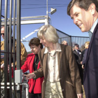"""Agriculture Secretary Ann Veneman, Interior Secretary Gale Norton, Oregon Senator Gordon Smith, left to right, at opening of the """"A"""" Canal headgates of the Klamath Falls, Oregon dam, releasing water to Klamath Basin farmers. Decision to release the water came amid environmental policy debate"""