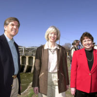 """Oregon Senator Gordon Smith, Interior Secretary Gale Norton, and Agriculture Secretary Ann Veneman, left to right, in Klamath Falls, Oregon for the opening of the """"A"""" Canal headgates to release water to Klamath Basin farmers, amid debate involving irrigators, tribal leaders, environmentalists, federal andstate officials"""