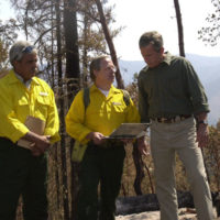 President George Bush visiting the site of the Squire Peak forest fire, Ruch, Oregon, for surveys of the damage, discussions with Bureau of Land Management, state, and local officials and firefighters, and policy announcements