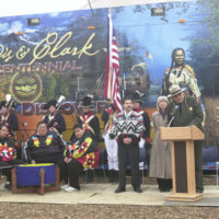 Lewis and Clark National Historic Trail Superintendent, and Mandan-Hidatsa Tribe member, Gerard Baker, at podium, with Fort Belknap Indian ReservationVice Chairman Darrell Martin and Secretary Gale Norton nearest him, left to right, at Lewis and Clark Bicentennial exhibit opening, Washington, D.C.
