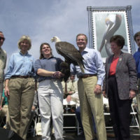 Disney Company Vice Chairman Roy Disney, far left, with Secretary Gale Norton, Centennial Chairman William Horn, fourth from left, and Fish and Wildlife Service's Steve Williams, far right, during bald eagle display at Pelican Island National Wildlife Refuge, Sebastian, Florida centennial ceremony