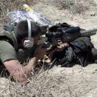 US Marine Corps (USMC) Scout Snipers aim their M40A1 Sniper