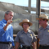 President George Bush, National Park Service Director Fran Mainella, and Santa Monica Mountains National Recreation Area Superintendent Woody Smeck, left to right, during Presidential visit to the Recreation Area in Thousand Oaks, California. Visit highlighted the federal budget commitment to National Park system maintenance