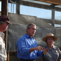 Ralph Waycott, far left, volunteer coordinator for the Rancho Sierra Vista Nursery, with President George Bush, National Park Service Director Fran Mainella, Santa Monica Mountains National Recreation Area Superintendent Woody Smeck, left to right, during Presidential visit to the Recreation Area, ThousandOaks, California. Visit highlighted federal commitment to Park system maintenance