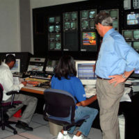 Sandra Long, Switcher Operator, monitors live news broadcasted from