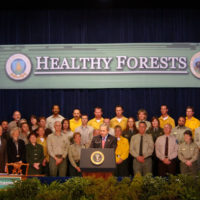 President George Bush speaking at signing ceremony for the Healthy Forests Restoration Act at Department of Agriculture headquarters
