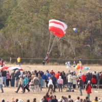 Skydiver team demonstration, among activities marking the centennial of the first powered flight, Wright Brothers National Memorial, Kill Devil Hills, North Carolina