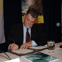 National Park Foundation President Jim Maddy providing his signature at Washington, D.C. signing event for National Park Service-National Park Foundation-Travel Industry Association of America agreement promoting See America's National Parks campaign
