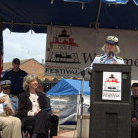 Rear Admiral Sally Brice-O'Hara, Commander of the 5th District U.S. Coast Guard, speaking at ceremonies in Annapolis, Maryland marking the transfer of the Thomas Point Shoal Lighthouse from the Coast Guard to the city of Annapolis and its non-profit partner, the U.S. Lighthouse Society