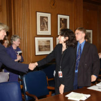 Interior Secretary Gale Norton, left, greeting attendees at briefing, Washington, D.C., where she joined Agriculture Secretary Ann Veneman and Environmental Protection Agency Administrator Michael Leavitt, among other officials