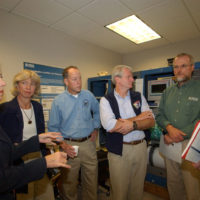 Visit of Washington Senator Maria Cantwell, Secretary Gale Norton, Oregon Congressman Greg Walden, and Washington Congressman Brian Baird, left to right, to the U.S. Geological Survey's Cascades Volcano Observatory in Vancouver, Washington, where they received tour and Mount St. Helens briefing from volcanologist Dan Miller, far right