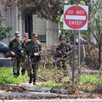 An Army National Guard (ARNG) Military Police (MP) unit patrols the streets of Jefferson Parish and provides security and rescue to victims of Hurricane Katrina. (A3614)