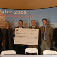 Utah Governor Jon Huntsman, Jr., far left, Secretary Gale Norton, second from left, and Assistant Secretary for Water and Science Mark Limbaugh, far right, join awardee staff at announcement of Water 2025 Challenge Grant for Utah's Metropolitan Water District of Salt Lake and Sandy, during ceremony in Orem, Utah marking roll-out of federal funding for 11 water projects in Utah, one in Idaho