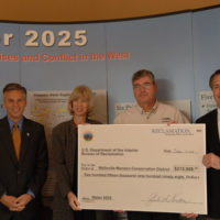 Utah Governor Jon Huntsman, Jr., far left, Secretary Gale Norton, second from left, and Assistant Secretary for Water and Science Mark Limbaugh, far right, joining awardee staff at announcement of Water 2025 Challenge Grant for Utah's Wellsville-Mendon Conservation District, during ceremony in Orem, Utah marking roll-out of federal funding for 11 water projects in Utah, one in Idaho