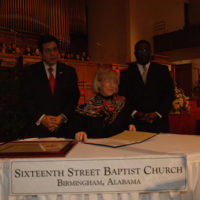 U.S. Attorney General Alberto Gonzales, far left, with Secretary Gale Norton and Arthur Price, Jr., Pastor of the Sixteenth Street Baptist Church, Birmingham, Alabama, at ceremonies designating the Church, key civil rights movement meeting place and site of 1963 bombing, as National Historic Landmark