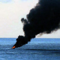 An armed pirate skiff, ignites in flames and burns to the waterline in international waters off the coast of Somalia (SOM), in the Indian Ocean. (SUBSTANDARD)