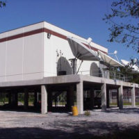 [Hurricane Katrina] WWL-TV in Gretna, Louisiana was able to broadcast uninterrupted throughout Hurricane Katrina. The construction manager designed the building specifically to withstand high winds and flooding. Notice that the equipment is elevated and that the space under the building can now be used as parking space. Photo by FEMA.